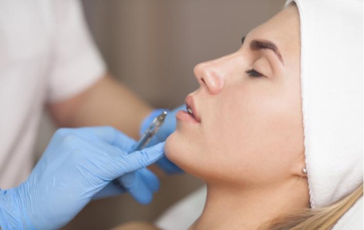 A woman receiving a dermal filler to rejuvenate her skin